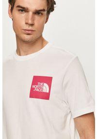 Biały t-shirt The North Face z okrągłym kołnierzem, z nadrukiem