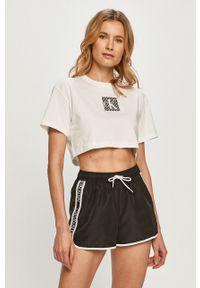 Calvin Klein Jeans - T-shirt. Okazja: na co dzień. Kolor: biały. Materiał: bawełna, dzianina. Wzór: nadruk. Styl: casual