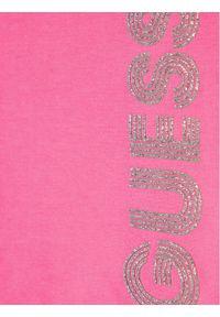 Guess Spodnie dresowe K1YQ11 KA6V0 Różowy Regular Fit. Kolor: różowy. Materiał: dresówka