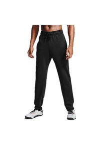 Spodnie męskie sportowe Under Armour Rival Fleece 1357129. Materiał: skóra, bawełna, polar, poliester. Sport: fitness