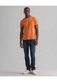 GANT - Granatowe jeansy Slim Fit. Kolor: niebieski