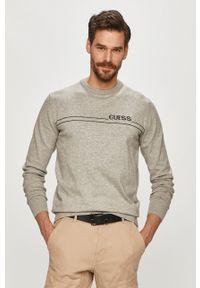 Guess - Sweter. Kolor: szary. Materiał: dzianina. Długość rękawa: długi rękaw. Długość: długie