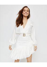 Balmain - BALMAIN - Biała sukienka z jedwabiu. Okazja: na spotkanie biznesowe. Kolor: biały. Materiał: jedwab. Wzór: kropki. Typ sukienki: asymetryczne. Styl: biznesowy