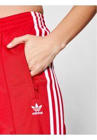 Czerwone spodnie dresowe Adidas