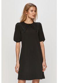 Vero Moda - Sukienka. Kolor: czarny. Materiał: dzianina. Długość rękawa: krótki rękaw. Wzór: gładki