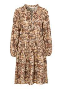 Cream Sukienka z wiskozy Augusta rdzawy we wzory female brązowy/pomarańczowy/ze wzorem 46. Typ kołnierza: dekolt w serek. Kolor: brązowy, wielokolorowy, pomarańczowy. Materiał: wiskoza. Długość rękawa: długi rękaw