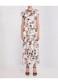 Beżowa sukienka na wiosnę, maxi, w kolorowe wzory