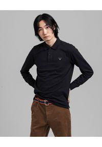 GANT - Czarna koszulka polo z długim rekawem. Okazja: na co dzień. Typ kołnierza: polo. Kolor: czarny. Materiał: bawełna. Długość rękawa: długi rękaw. Długość: długie. Styl: klasyczny, casual