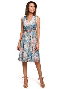 e-margeritka - Sukienka szyfonowa bez rękawów kwiaty niebieska - xl. Okazja: na wesele, na ślub cywilny, na imprezę. Kolor: niebieski. Materiał: szyfon. Długość rękawa: bez rękawów. Wzór: kwiaty. Typ sukienki: proste, rozkloszowane. Styl: elegancki