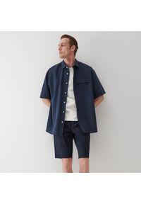 Reserved - Szorty z elastycznym pasem - Granatowy. Kolor: niebieski