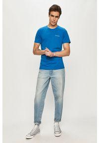 columbia - Columbia - T-shirt. Okazja: na co dzień. Kolor: niebieski. Materiał: włókno, dzianina, skóra, syntetyk. Wzór: jednolity, ze splotem, gładki. Styl: casual
