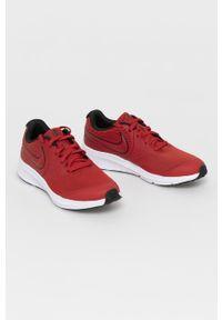 Czerwone buty sportowe Nike Kids z okrągłym noskiem, z cholewką, na sznurówki