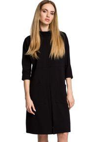 MOE - Prosta sukienka oversize z dużymi kieszeniami. Okazja: na spacer, na co dzień, do pracy. Materiał: dresówka, dzianina, elastan, materiał, bawełna. Typ sukienki: proste, oversize. Styl: casual