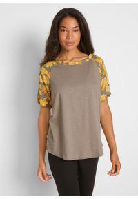 Bluzka shirtowa z rozcięciami po bokach, z przyjaznej dla środowiska wiskozy bonprix jasnooliwkowy - kremowy żółty w kwiaty. Kolor: zielony. Materiał: wiskoza. Wzór: kwiaty
