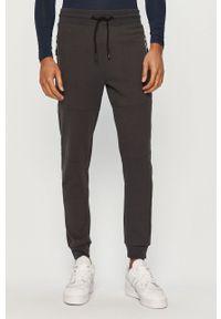 Szare spodnie dresowe 4f z nadrukiem