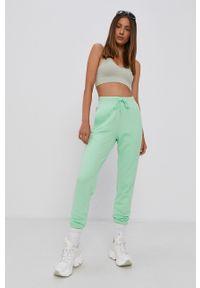 adidas Originals - Adidas Originals - Spodnie. Kolor: zielony. Materiał: bawełna