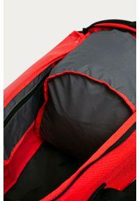 Pomarańczowa torba podróżna Nike z nadrukiem