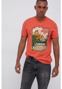 Superdry - T-shirt. Okazja: na co dzień. Kolor: pomarańczowy. Wzór: nadruk. Styl: casual