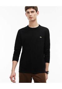 Lacoste - LACOSTE - Czarna koszulka z długim rękawem. Okazja: na co dzień. Kolor: czarny. Materiał: bawełna, jeans. Długość rękawa: długi rękaw. Długość: długie. Wzór: haft. Styl: klasyczny, casual