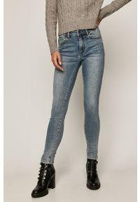 Niebieskie jeansy medicine w kolorowe wzory