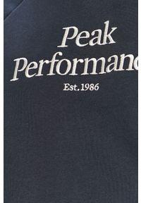 Niebieska bluza nierozpinana Peak Performance raglanowy rękaw, z aplikacjami