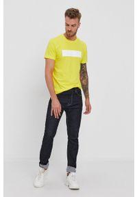 Calvin Klein Jeans - T-shirt. Okazja: na co dzień. Kolor: żółty. Materiał: lycra. Wzór: nadruk. Styl: casual