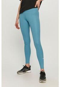 Nike - Legginsy. Stan: podwyższony. Kolor: niebieski. Materiał: tkanina, dzianina, poliester, elastan, włókno, skóra. Wzór: gładki #1