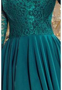 Numoco - Ekskluzywna asymetryczna sukienka z koronkową górą. Okazja: na wesele, na ślub cywilny, na imprezę. Materiał: koronka. Wzór: koronka. Typ sukienki: asymetryczne. Styl: wizytowy