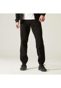 DOMYOS - Spodnie dresowe fitness. Kolor: czarny. Materiał: dresówka. Sport: fitness