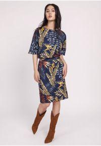 e-margeritka - Sukienka kimonowa elegancka granatowa - 44. Okazja: do pracy. Kolor: niebieski. Materiał: materiał, poliester. Typ sukienki: ołówkowe, dopasowane. Styl: elegancki. Długość: midi