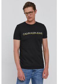 Calvin Klein Jeans - T-shirt. Okazja: na co dzień. Kolor: czarny. Materiał: bawełna, dzianina. Wzór: nadruk. Styl: casual