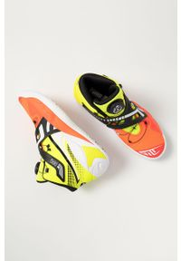 Żółte sneakersy Puma z cholewką, na sznurówki