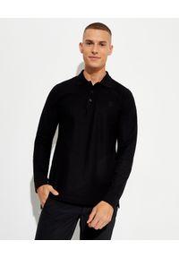 Burberry - BURBERRY - Koszulka polo z długim rękawem. Typ kołnierza: polo. Kolor: czarny. Materiał: bawełna. Długość rękawa: długi rękaw. Długość: długie. Wzór: haft. Styl: klasyczny