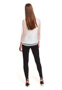 TOP SECRET - Elegancka bluzka o luźnym kroju. Kolor: biały. Materiał: tiul. Długość: długie. Wzór: aplikacja. Sezon: jesień. Styl: elegancki