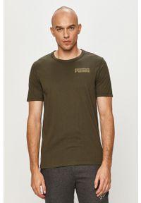 Brązowy t-shirt Puma casualowy, z nadrukiem, na co dzień