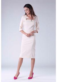 Beżowa sukienka na imprezę Nommo elegancka