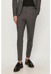 Calvin Klein - Spodnie. Kolor: szary
