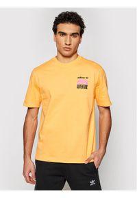 Pomarańczowy t-shirt Adidas z nadrukiem