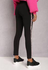 Renee - Czarne Legginsy Corica. Kolor: czarny. Materiał: materiał, guma. Wzór: aplikacja, nadruk. Styl: sportowy