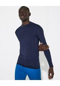 Lacoste - LACOSTE - Granatowy longsleeve z tkaniny technicznej. Kolor: niebieski. Materiał: tkanina. Długość rękawa: długi rękaw. Długość: długie. Wzór: haft, aplikacja. Styl: sportowy