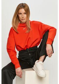 Nike - Bluza. Typ kołnierza: kaptur. Kolor: czerwony. Materiał: tkanina, skóra, włókno, dzianina. Długość rękawa: długi rękaw. Długość: długie