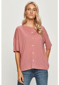 Różowa bluzka Nike na co dzień, z nadrukiem, sportowa