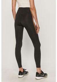 Nike - Legginsy. Kolor: czarny. Materiał: tkanina, dzianina, skóra, włókno. Technologia: Dri-Fit (Nike)