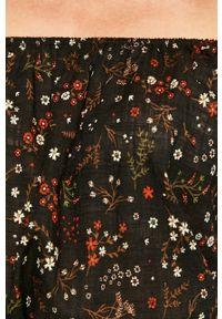 Czarna bluzka medicine w kwiaty, z dekoltem typu hiszpanka