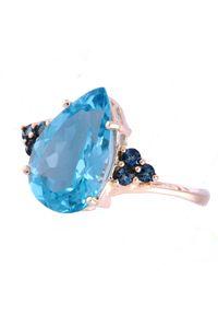 Braccatta - OCEAN BŁĘKITU Złoty pierścionek z niebieskim topazem 5,35 ct. Materiał: złote. Kolor: niebieski, złoty, wielokolorowy. Kamień szlachetny: topaz