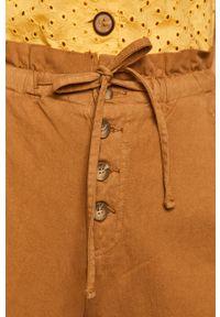 Złote spodnie materiałowe medicine z podwyższonym stanem
