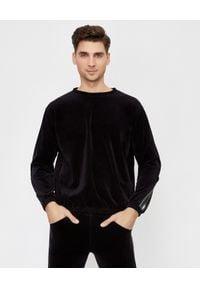 JOANNA MUZYK - Czarna bluza z taśmami z logo. Kolor: czarny. Materiał: dresówka, materiał, bawełna