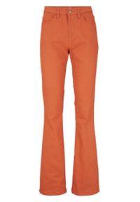 Pomarańczowe jeansy bonprix