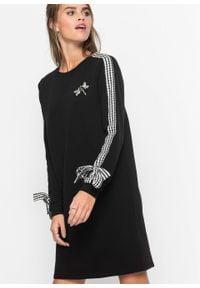 Sukienka dresowa z kokardkami i aplikacją bonprix czarny. Typ kołnierza: kokarda. Kolor: czarny. Materiał: dresówka. Wzór: aplikacja