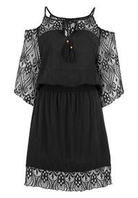 Czarna sukienka bonprix rozkloszowana, w koronkowe wzory, na plażę
